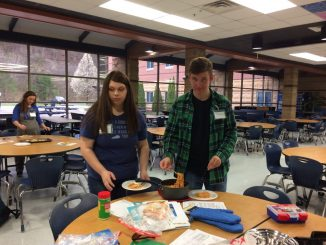 Students are shown participating in a recent cooking club held by HealthCorps at Knox Central.