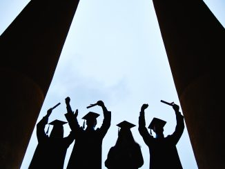 Outlines of four graduates with certificates outside