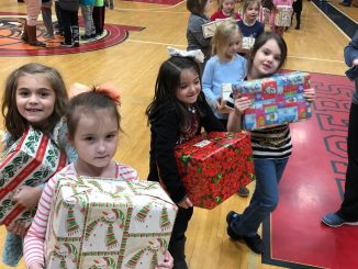 Students at Girdler shown accepting gifts