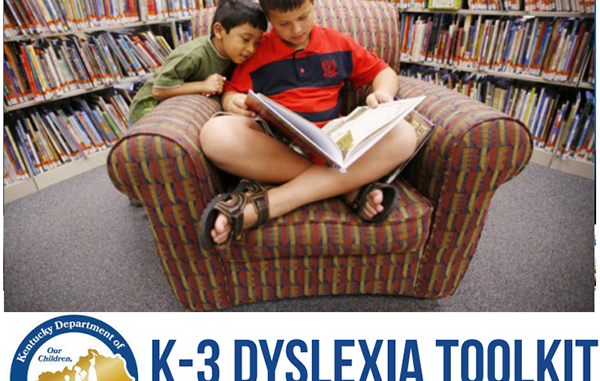 Front cover of the dyslexia toolkit showing two students reading a book.
