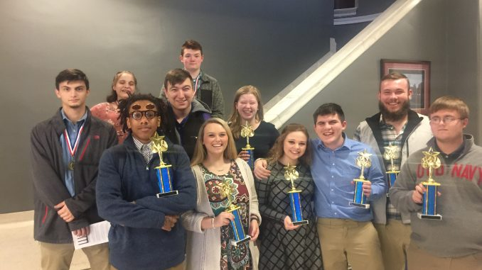 Lynn Camp DECA students shown with trophies and medals after the regional competition.