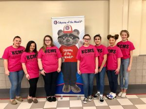 Knox County Middle School's Odyssey of the Mind team pose for a first place photo with the Omer banner behind them.