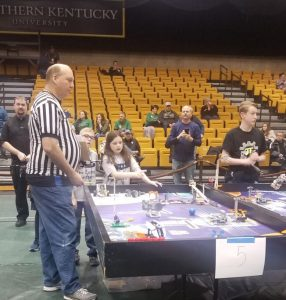 An action shot of students competing in the Lego robotics competition.
