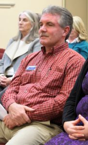 Kim Merida is shown in the audience attending his last Board meeting as Facilities Coordinator on January 28, 2019.