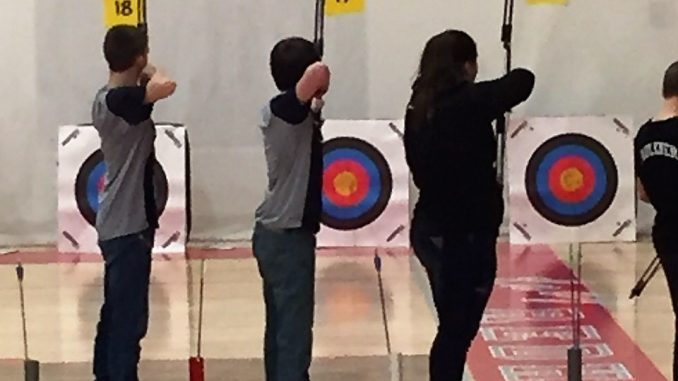 Knox County's archery members are shown taking aim at targets