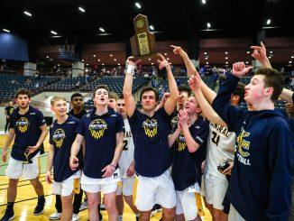 Players are shown at The Arena with winning trophy in hand, 13th Region Champions.