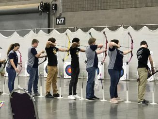 Ready, aim, the Knox Central archers are shown getting ready to shoot at the state tournament.