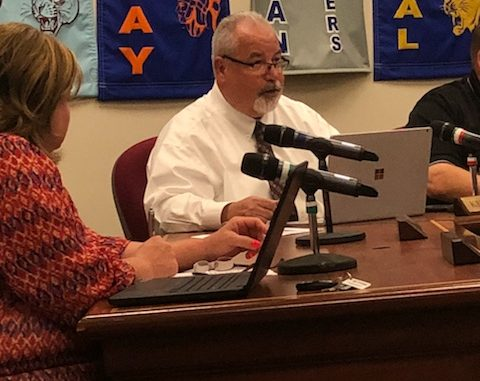 Kelly Sprinkles is shown at the Board table during the June 2019 meeting. Carrie Smith is shown to left.