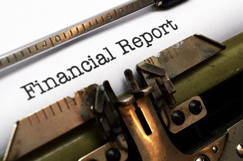 Stock image of typewriter with text Financial Report