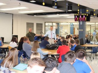 Assembly shown in the Knox Central cafeteria with Jeff Canady and Jeff Frost at the microphone addressing students.