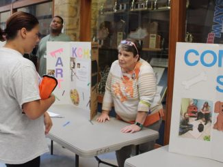 A student is shown at the Community Service exhibit during RUSH week at Knox Central.