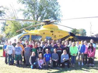 Lay students posed for a photo in front of the Air Medic helicopter as part of school safety week
