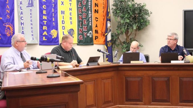 Superintendent Sprinkles and Board Members Hendrickson, Ashburn, and Hinkle discuss items at the October meeting.