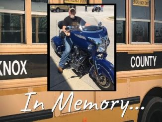 "Bus in background, photo of Tommy Marlow in front with text ""In Memory..."""