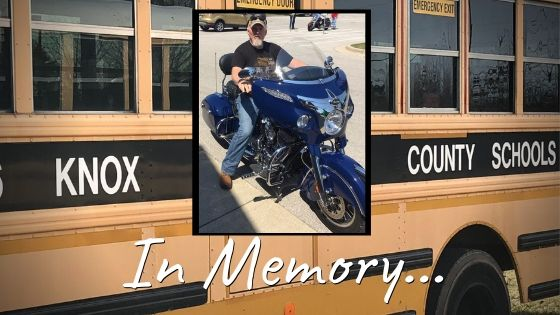 """Bus in background, photo of Tommy Marlow in front with text """"In Memory..."""""""