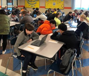 The CERT assessment was administered to students in the cafeteria at Lynn Camp. Shown are students with their computers taking the timed assessments.