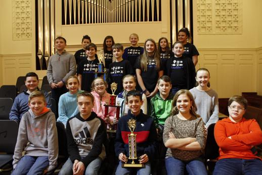 Students pose for a photo after receiving awards at the Academic League ceremony.