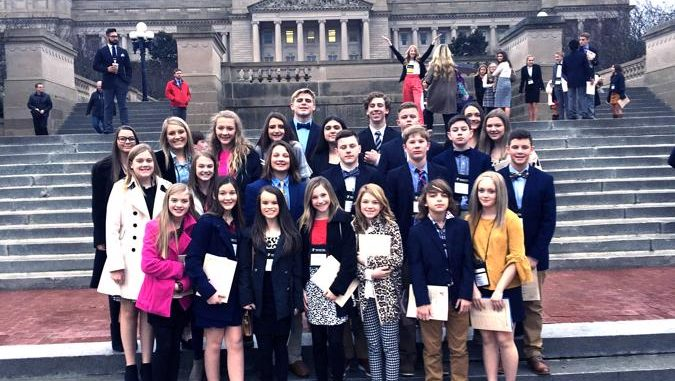 KCMS students pose in front of the Capitol during their visit to KYA.
