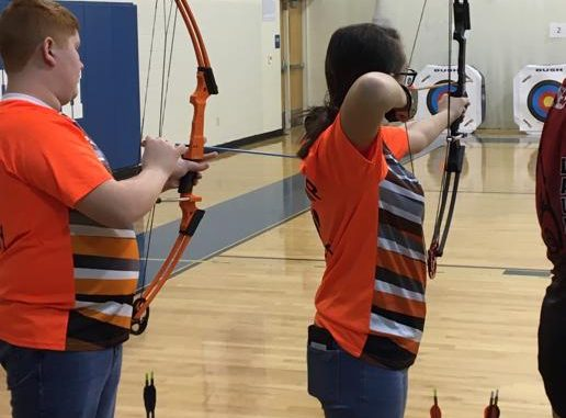 Two Lynn Camp archers are shown ready to shoot.