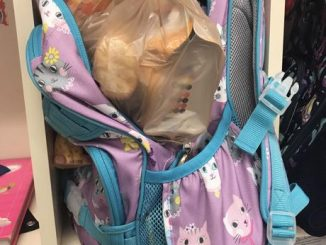 Backpack filled with food shown in a cubical in a local school.