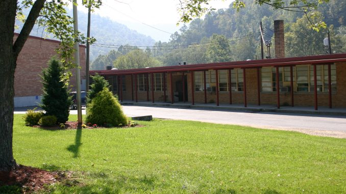 Exterior view of Dewitt Elementary School showing the front of the school and attached gymnasium.