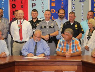 Superintendent Sprinkles signing the proclamation