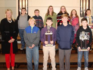 Students receive awards during the annual Academic League ceremony.