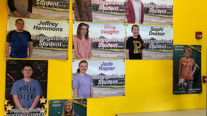 Banners display photos of students who scored Distinguished on KPREP at Central.