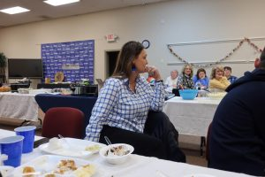 Stacy Imel listens to Mr. Merida share stories of her and him during their time at the Learning Academy.