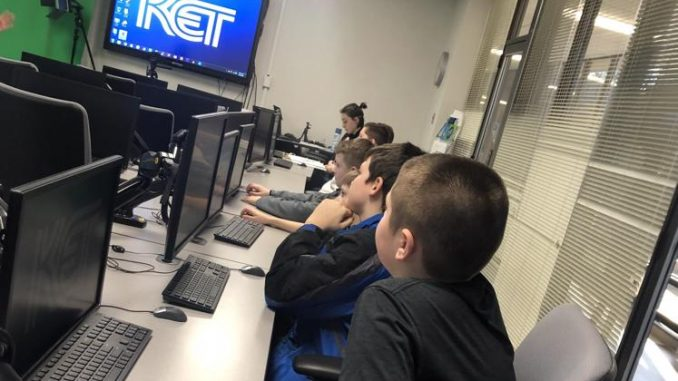 Students are shown in the learning lab at KET with computers and green screen technology.