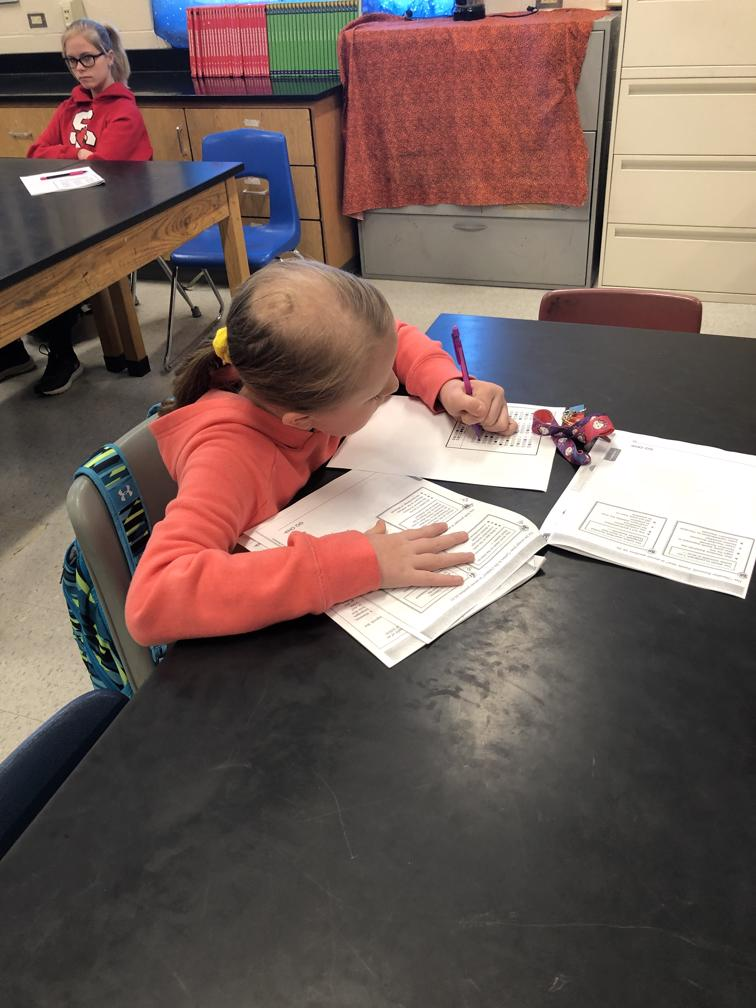A student is shown writing a response to the K-Prep like exam given at Lynn Camp Middle.