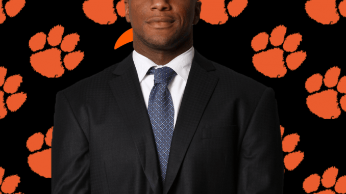 Rodney Clarke is shown in front of a LC cat paw background