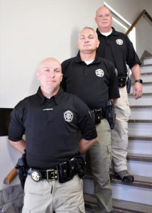 School Resource Officers Steve Owens, Mike Broughton, and Patrick Clouse are shown at Central Office.