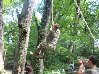 Michael Asher competing in the vertical rope challenge.