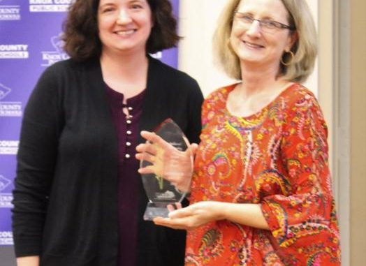 Marla Carnes is shown presenting an award to Knox County's Gertrude Smith