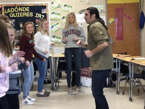 Yani Vozos is shown teaching Spanish students different dance moves.