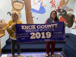 Sheila Terrell and Gina Sears hold the Knox Middle High Attendance Banner