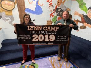 Gina Sears and Anthony Pennington hold the Lynn Camp High Attendance Banner