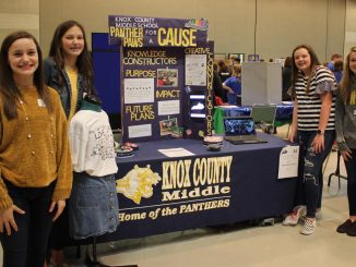 KCMS students are shown at their exhibit during the regional STLP promoting their community service project.