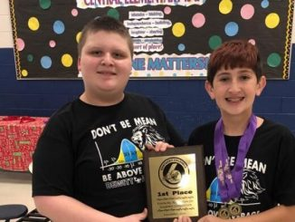 Two students from Dewitt Elementary hold the overall first place winning plaque.
