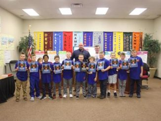 Lay Elementary B team line up for a photo with certificates presented by the Board.
