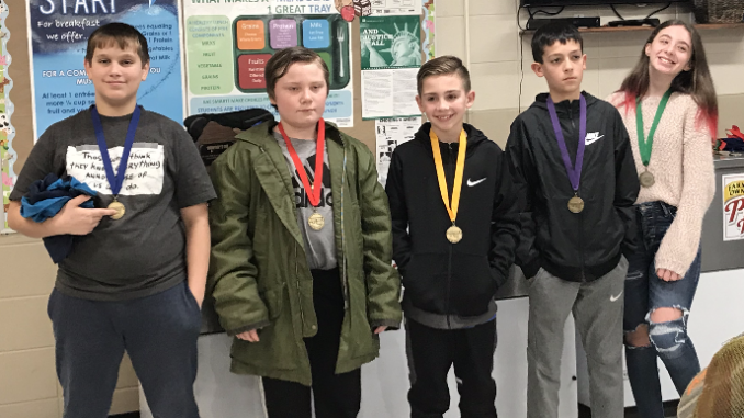 Five students shown with their Governors Cup medals.