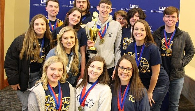 KC students hold trophies and wear ribbons at the event.