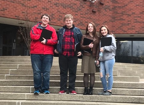 Four Lynn Camp choir students shown outside UofL college of music.