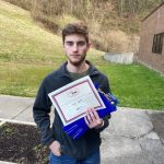 Cody Smith shown with certificate.