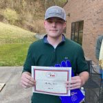 Matthew Warren shown with certificate.