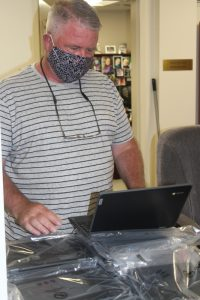 Kevin Parsons is shown with an open Chromebook.