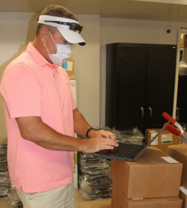 Lee Worley is shown logging into a new Chromebook