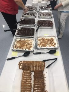 Knox Central's dessert table featuring pumpkin rolls and other various items.