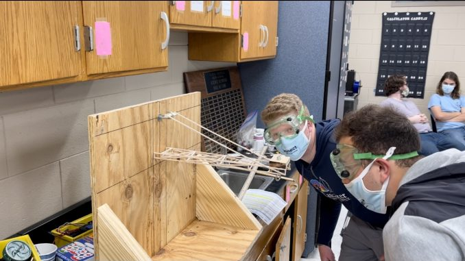 Students are shown constructing one of their many projects for Science Olympiad.